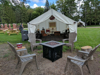 Seating inside and outside the glamping tent